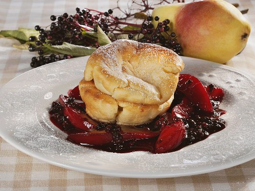 Pfitzauf (baked batter cake) with elderberry & pear compote