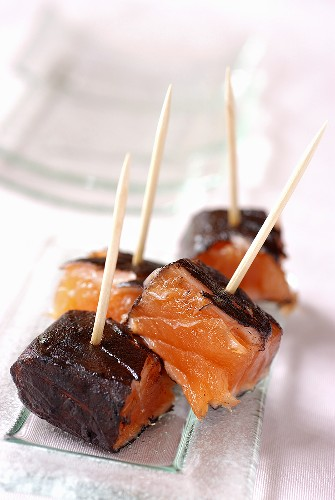 Fried salmon cubes with cuttlefish ink