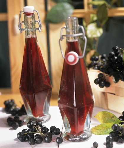 Chokeberry juice in two bottles