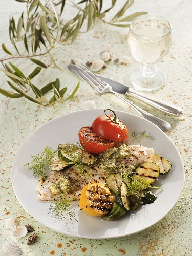Grilled pangasius fillet and vegetables with dill pesto