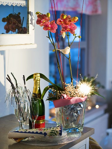 Christmas decoration with an orchid and a sparkler