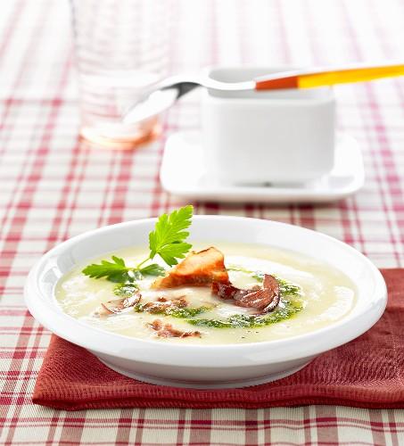 Potato soup with green almond pesto