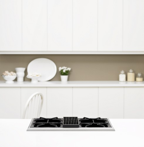 White kitchen units with gas hob