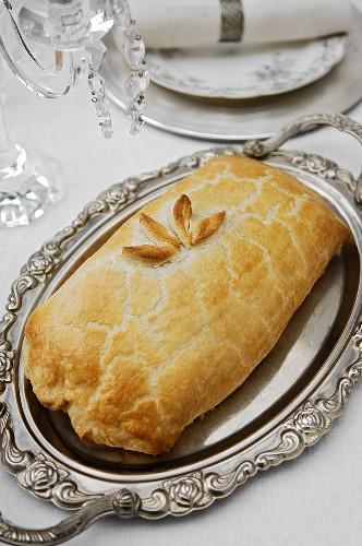 Filet Wellington on a silver platter