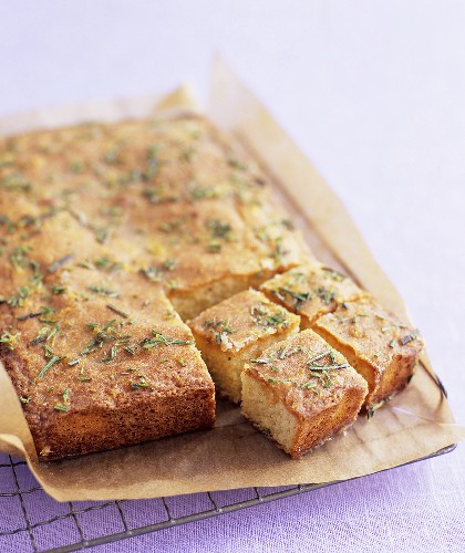 Lemon and rosemary cake on a wire rack
