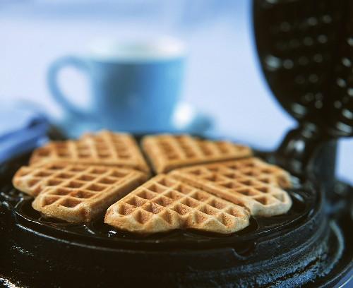 Cinnamon waffles in a waffle iron