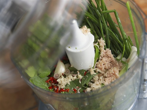 Ingredients for green curry in a liquidizer