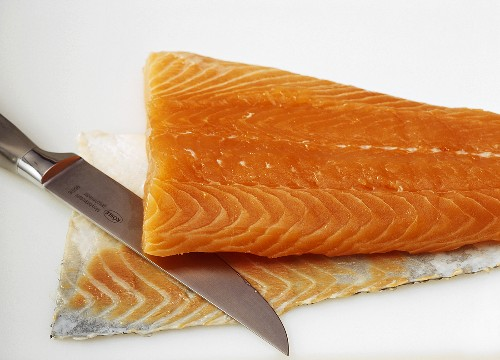Removing the skin & fat layer from salmon fillet with knife