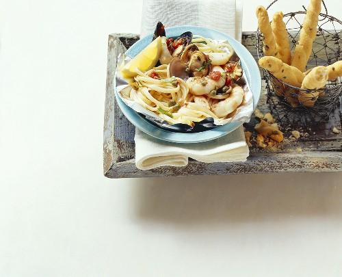 Linguine al cartoccio (Linguine with seafood, Italy)