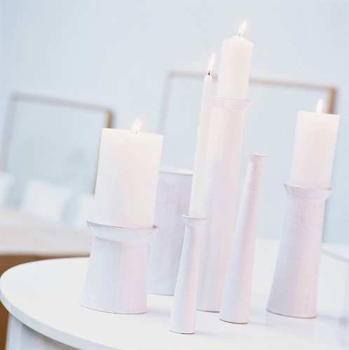 Burning candles in candle holders