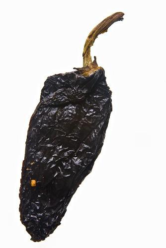 A dried chilli pepper (chile ancho, broad chilli pepper)