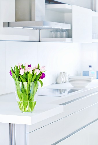 A bunch of tulips in a white kitchen