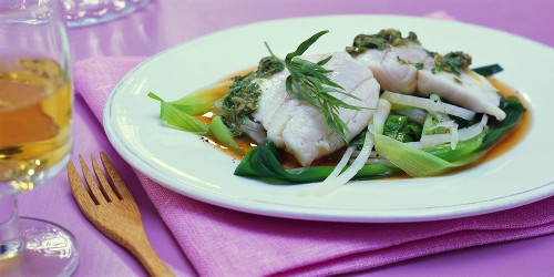 Steamed fish fillets on spring onions and kohlrabi