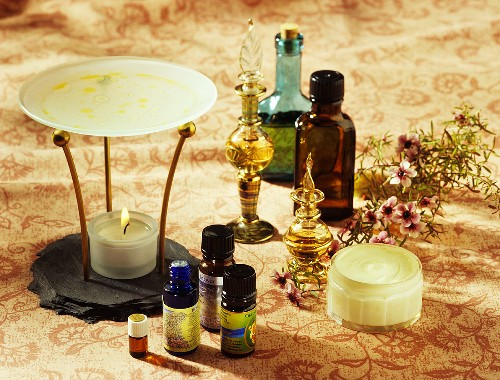 Aroma lamp, aromatic oils in small bottles, flacons and cream