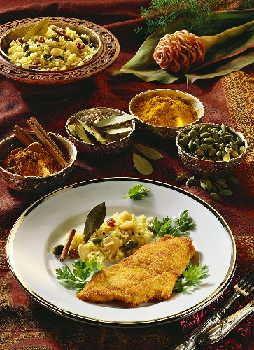 Breaded, marinated chicken breast with pilau