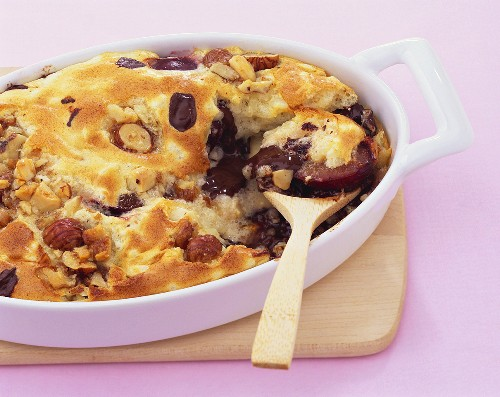Baked rice dessert with fruit and chocolate