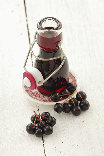 Chokeberry juice in a small bottle