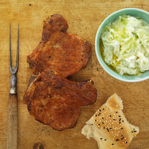 Pork chops with a cucumber-yogurt dip and unlevened bread
