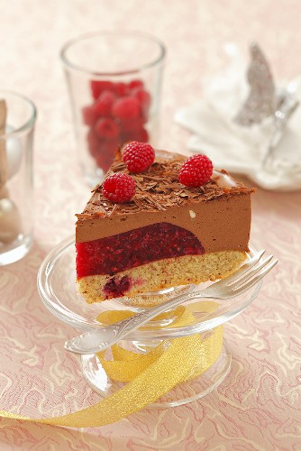 A piece of Christmas chocolate mousse tart with raspberries