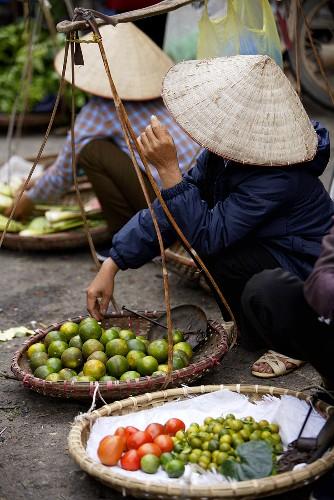 Vietnamese women selling fruit & vegetables at a street market
