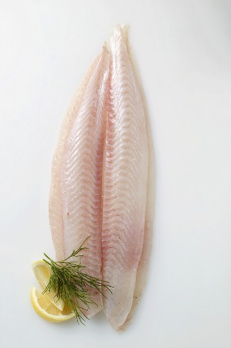 A fresh pangasius fillet with dill and lemon