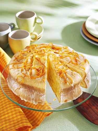 Advocaat cake on glass plate, a piece cut