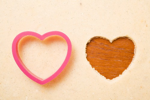 Biscuit dough with a heart-shaped cutter