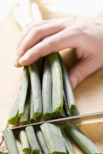 The green part being cut off spring onions
