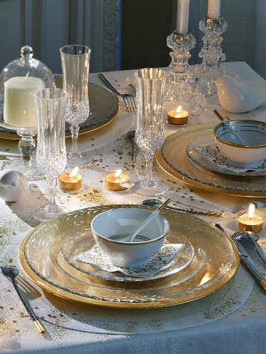 Christmas table with gold tableware and decoration