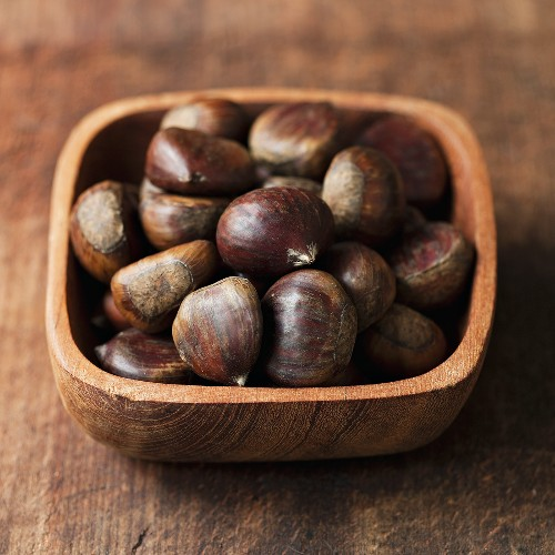 Sweet chestnuts in wooden bowl