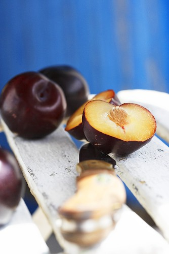 Fresh plums on wooden chair