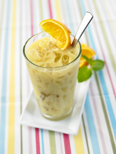 Orange and pineapple smoothie with coconut syrup