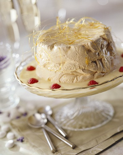 Nougat ice cream cake, caramel strands, custard & raspberries