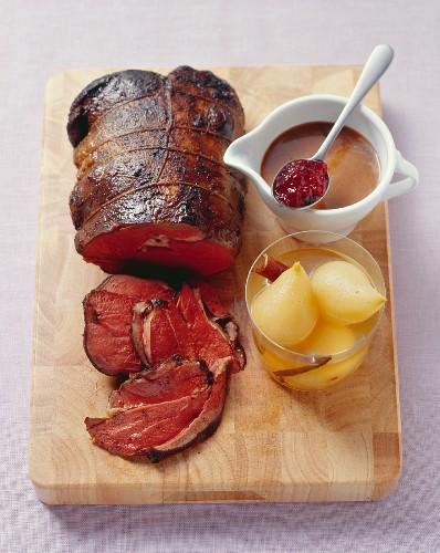Roast leg of venison (medium) with spiced pears