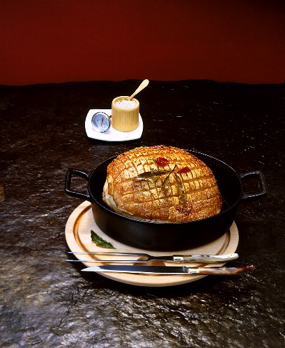 Roast pork with crackling in a roasting dish