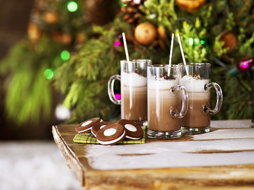 Irish hot chocolate & biscuits on garden table in front of Xmas tree