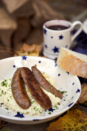 Sausages poached in beer on celeriac and apple mash