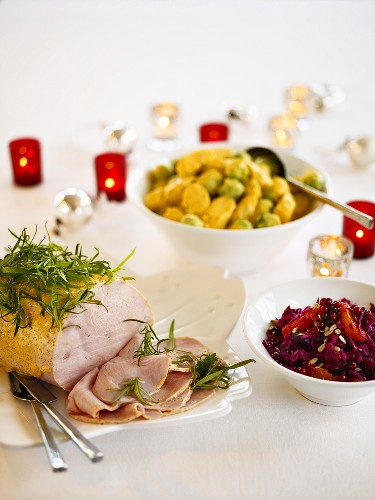 Mustard-glazed turkey joint, potatoes and Brussels sprouts, red cabbage