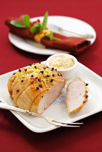 Roast ham studded with cloves for Christmas