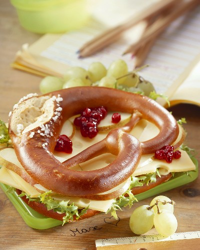 Cheese and pear slices in pretzel