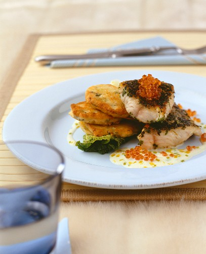 Fried catfish fillet with blinis