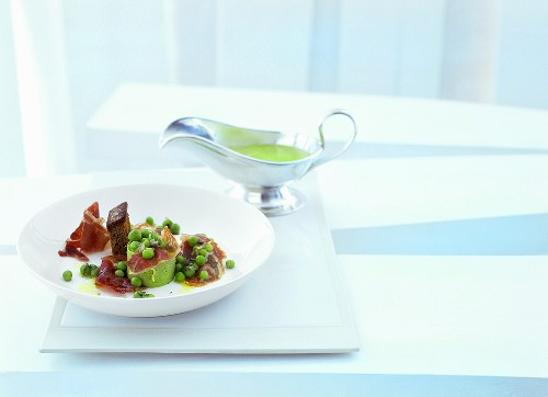 Pata negra with peas, mint and charcoal oil