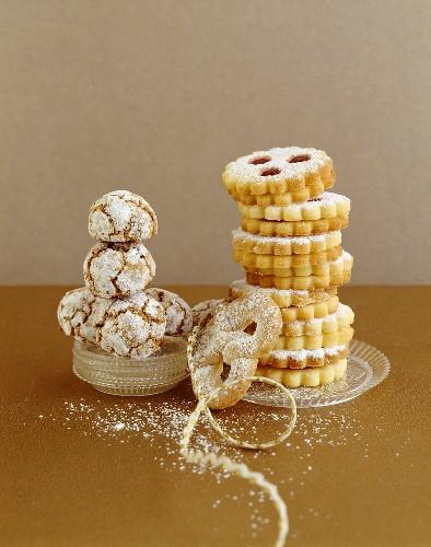 Schusterlaberl (chocolate meringue with icing sugar), almond pretzel and Linzer Augen (nutty shortcrust jam sandwich biscuits with holes on top)