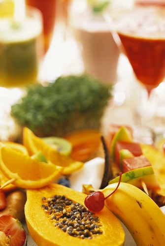 A display of various fruits and fitness drinks
