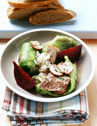 Pointed cabbage roulade with trip-tip steak and beetroot