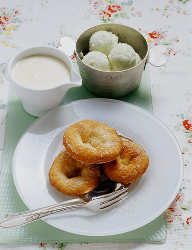 Swabian carneval cakes with a white wine cream and apple sorbet
