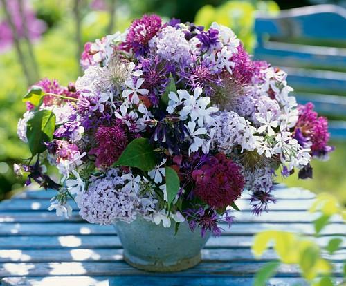 Vase of wild phlox, ornamental onions & perennial cornflower