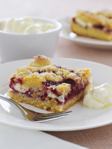 A piece of raspberry cake with white chocolate, cream