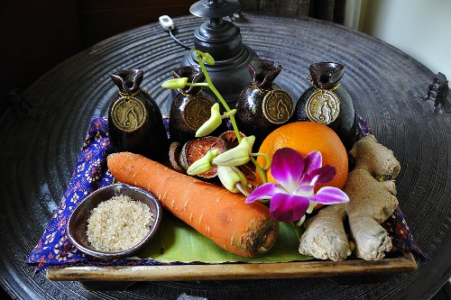 Spices, vegetables, flower and fruit on tray