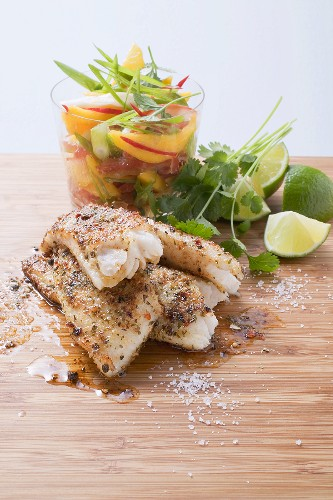 Cajun fish fillet with mango and tomato salad